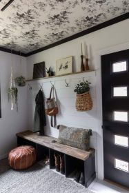 https://www.brightgreendoor.com/floral-modern-mudroom-with-black-wardrobes/