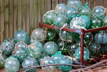 https://www.etsy.com/listing/156641811/vintage-glass-fishing-float-w-netting